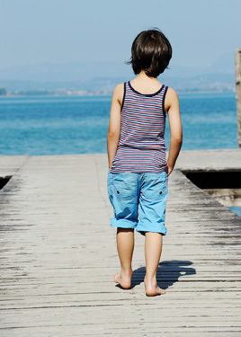 Child alone on a bridge