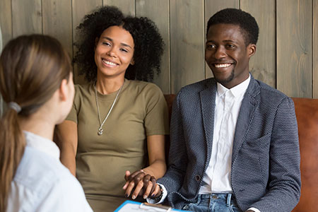 African American Couple in consultation with a reproductive endocrinologist.