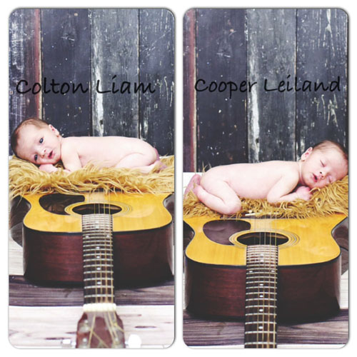 Colton and Cooper infant twins snuggled on top of two guitars